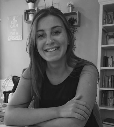 Black and white photograph of the author of the website smiling.